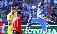 Kane Richardson (left) picked a five-wicket haul after Virat Kohli (right) scored his 25th ODI century.