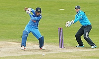 Smriti Mandhana (left) scored an unbeaten 43 for India in the chase.