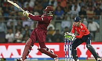 Chris Gayle slams a boundary during his innings against England