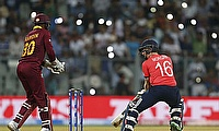 West Indies beat England in their opening ICC World Twenty20 match in Mumbai