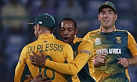 Aaron Phangiso (centre) picked the wickets of Dinesh Chandimal and Lahiru Thirimanne off successive deliveries.