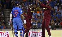 West Indian players celebrate the wicket of Ajinkya Rahane