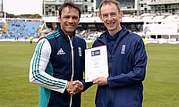 Chris Smith receives his award from Mark Ramprakash