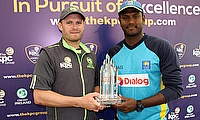 William Porterfield (left) and Angelo Mathews (right) posing with the trophy ahead of the series.