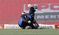 Adam Milne dives for a catch