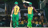 Dwayne Smith (right) celebrating his fifty for Guyana Amazon Warriors.