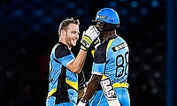 St Lucia Zouks team-mates David Miller and Darren Sammy celebrate