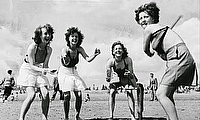 Women play cricket on the beach at Skegness in August 1940