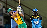 Chris Lynn hits out watched by Andre Fletcher
