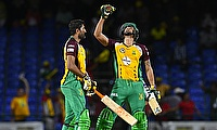 Sohail Tanvir (left) and Rayad Emrit (right) celebrating the victory over Jamaica Tallawahs