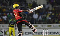 Dwayne Bravo plays a shot for Trinbago Knight Riders