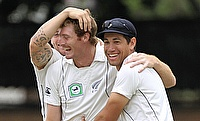 Martin Guptill (centre) picked three wickets in the second innings for New Zealand.