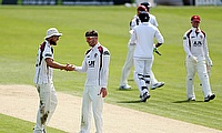 Rob Keogh (2nd from right) picked a nine-wicket haul for Northamptonshire on day two.