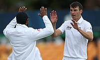 Toby Roland-Jones picked six wickets including a hat-trick to seal the championship for Middlesex.
