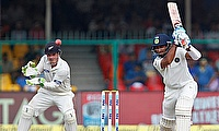 Cheteshwar Pujara (right) scored his third consecutive fifty in the series.