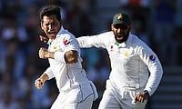 Yasir Shah (left) became the joint-second fastest to 100 wickets in Tests