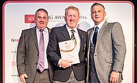 Stuart Kerrison (centre) collects the award on behalf of the Essex CCC team from Andy Russell (left) and Darren Gough (right)