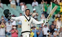 Usman Khawaja celebrating his century on day two of the Adelaide Test