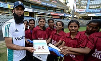 Moeen Ali (left) with girls from Mann Deshi project of British Asian Trust