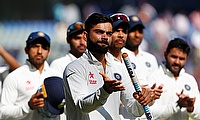 Indian captain Virat Kohli (centre) reacts after win over England in Mumbai