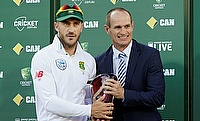 Faf du Plessis receiving the winning trophy from Kepler Wessels (right)