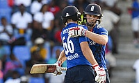 Joe Root (left) and Chris Woakes celebrating the win in Antigua