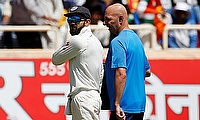 Virat Kohli (left) leaving the field in Ranchi with a shoulder injury