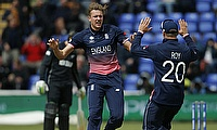 Jake Ball (centre) celebrating the wicket of Luke Ronchi