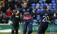 Jake Ball (centre) celebrating the wicket of Luke Ronchi