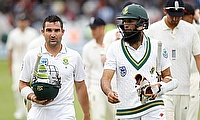 Dean Elgar (left) and Hashim Amla (right) walking off at the end of day two