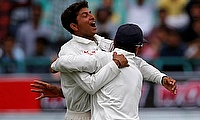 Kuldeep Yadav (left) picked four wickets in the game