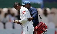 Asela Gunaratne (left) leaving the field on day one