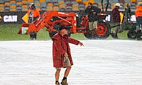 Kevin Mitchell directs his staff during a rain delay in the game between Australia and New Zealand