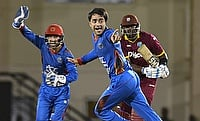 Rashid Khan (centre) has also represented IPL and CPL in the past