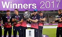 England's Eoin Morgan and team mates celebrate their win with the trophy