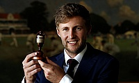 England's Joe Root poses with the urn at Lord's Cricket Ground