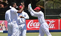 Shannon Gabriel (left) celebrating the wicket of Brendan Taylor