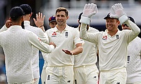 Chris Woakes (centre) was once again among the wickets