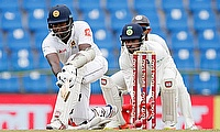 Angelo Mathews (left) announced his comeback with a half-century