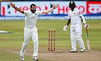 Mohammad Shami (left) made full use of the conditions at Eden Gardens