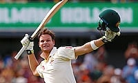 Steve Smith celebrates reaching his double century during the third day's play in Perth
