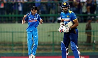 Yuzvendra Chahal (left) picked three wickets in the game