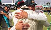 Australia's captain Steve Smith hugs team mates