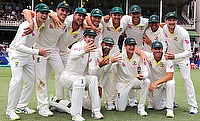Australia's captain Steve Smith holds a replica Ashes urn next to team mates after they won the fifth Ashes cricket test match and the series 4-0