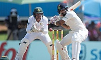 India's Virat Kohli (right) plays a shot in day two of the Centurion Test