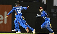 Rashid Khan (left) picked three wickets