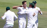 Morne Morkel (centre) completed 300 wickets on day two of Cape Town Test