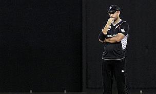 A pensive Daniel Vettori looks on