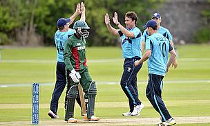 Neil Carter celebrates a wicket.