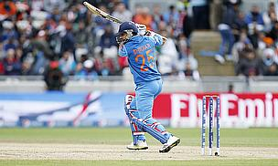 Shikhar Dhawan drives during the Champions Trophy